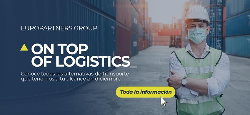 Un profesional de la logística, seguro con su cobrebocas, entrre conteiners, nos invita a dar clic en el banner para ser redireccionados al nuevo On top of logistics.