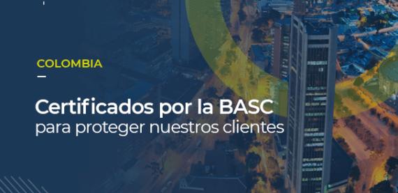 Sobre una foto de una moderna Bogotá, se puede leer COLOMBIA, certificados por la BASC para proteger nuestros clientes
